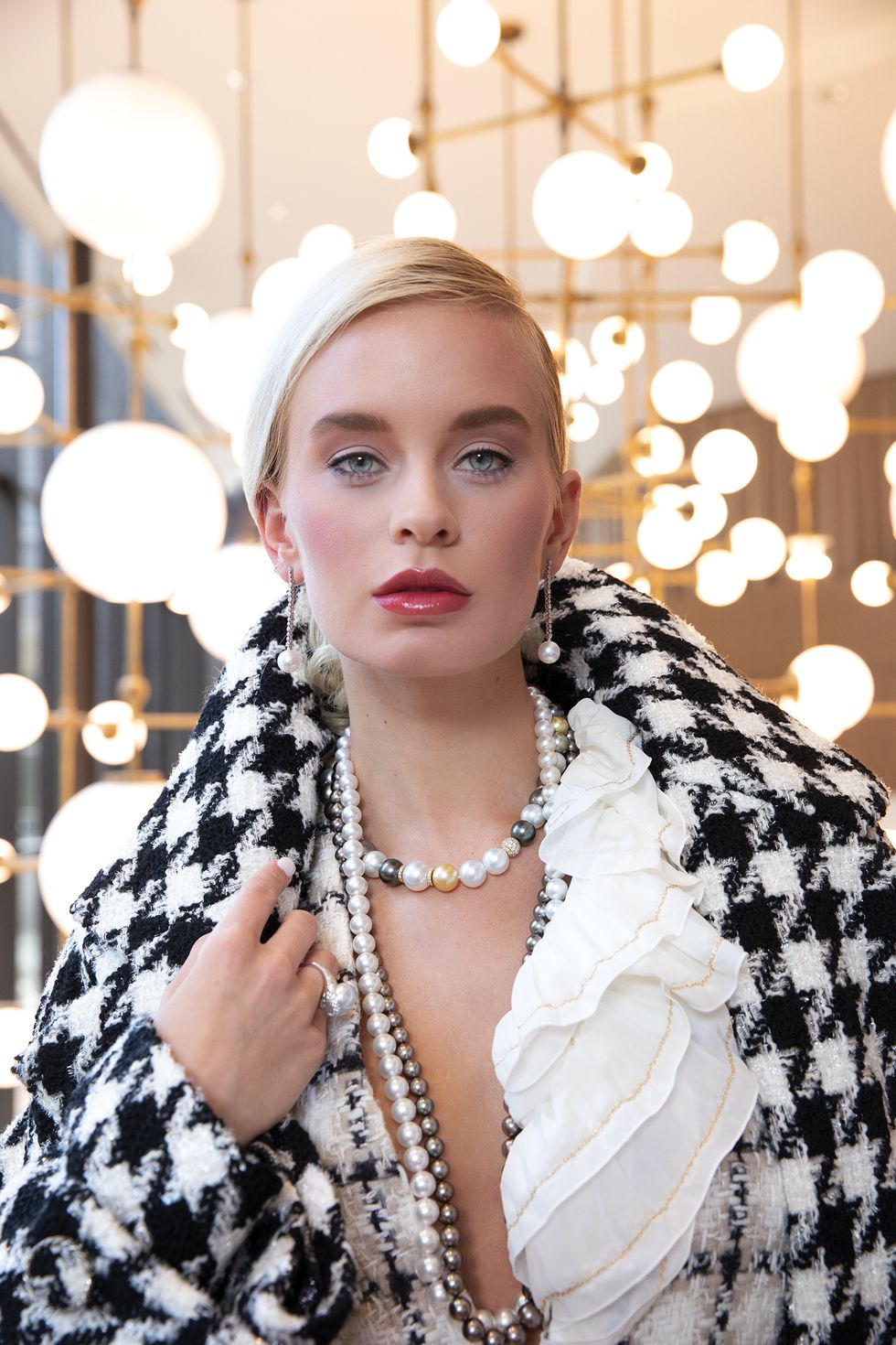 Crepe scarf, $2,350, tweed jacket, $5,400, and coat, $9,200, all by Chanel; pearl earrings, $18,000, ring, $9,800, and necklaces, from $16,500, all by Mikimoto at Zadok Jewelers.