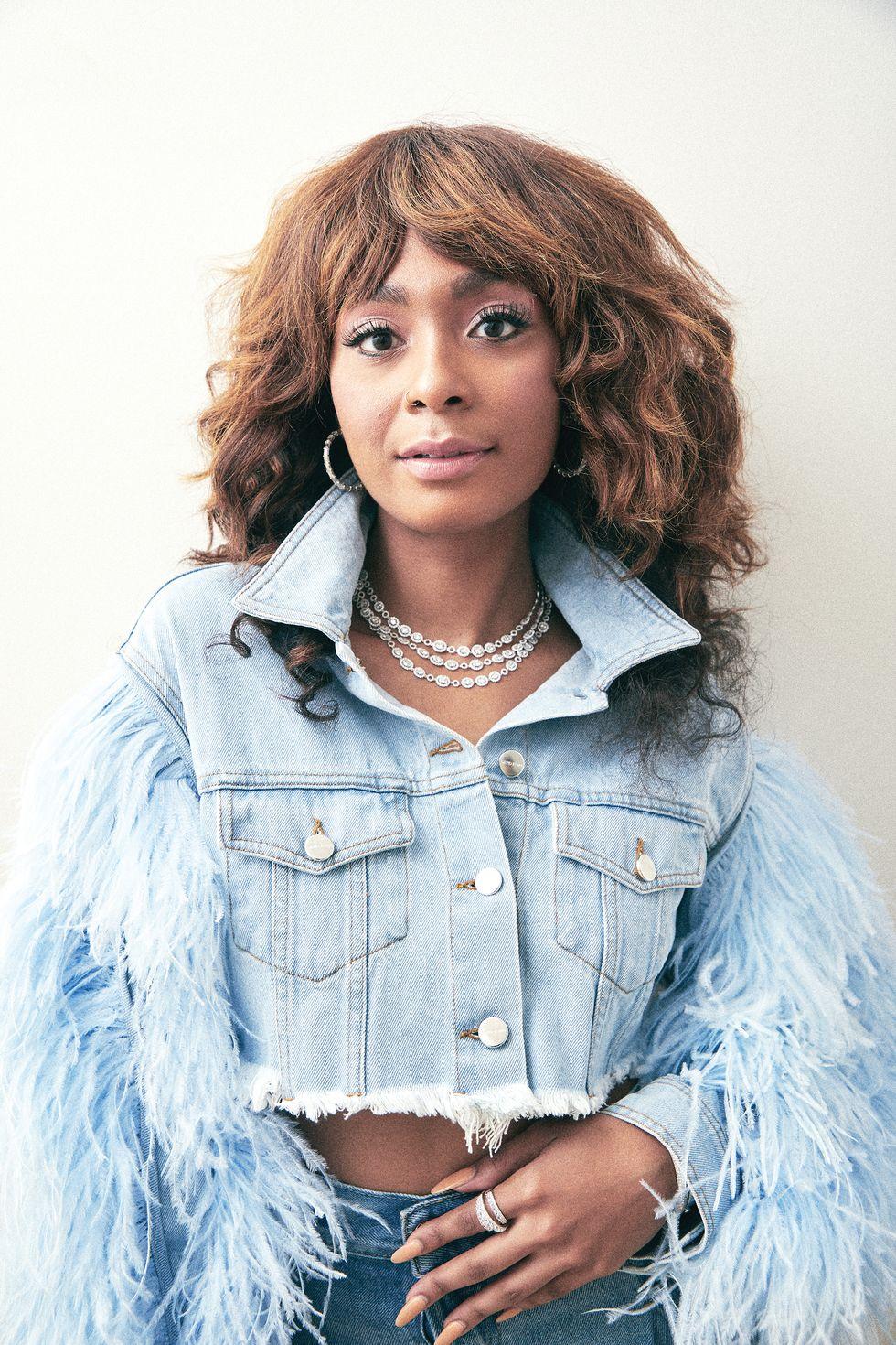 Lenora wears a David Koma jacket from Tootsies and  Deutsch Houston jewelry.