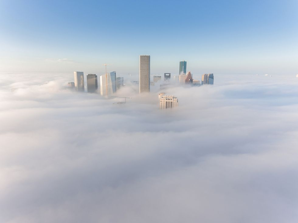 "Tenzo had this image in mind for months before he captured it. ""I had never seen Downtown photographed with low fog in the morning,"" he says. ""I kept track of the weather for months and asked meteorologists questions. Then I simply waited. One morning I could see fog out of my window. I jumped out of bed and knew this was going to be my chance. It came out exactly as I imagined it."""
