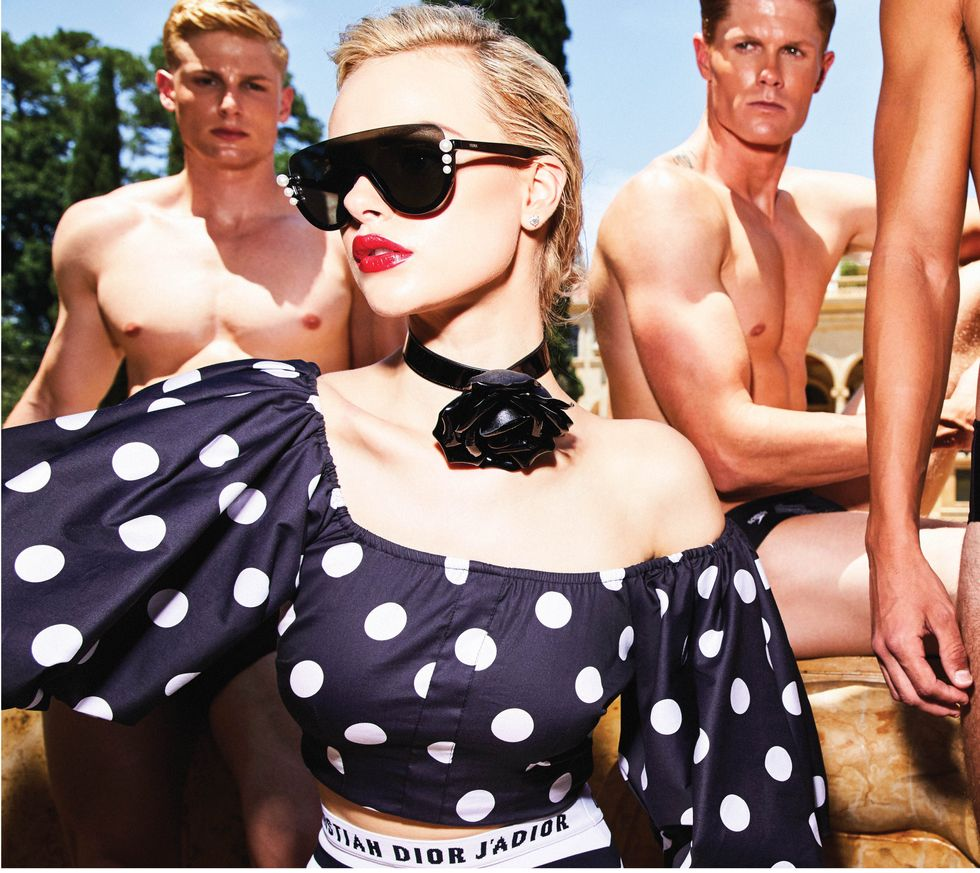 Swim bottoms, $970, by Christian Dior at The Webster; polka dot top, $395, by Caroline Constas, and patent rose choker, $895, by Saint Laurent, both at Neiman Marcus; sunglasses, $520, by Fendi at Saks Fifth Avenue. On the men: Black Speedos, $36.