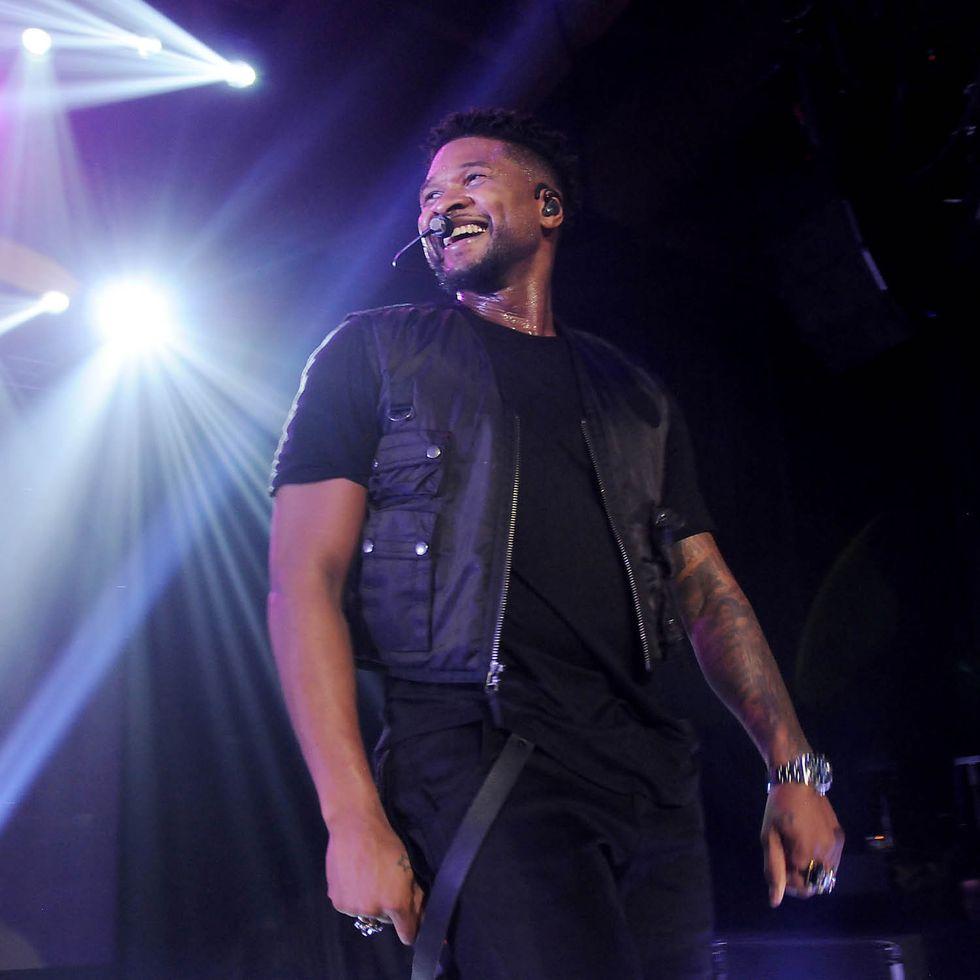 Usher performs