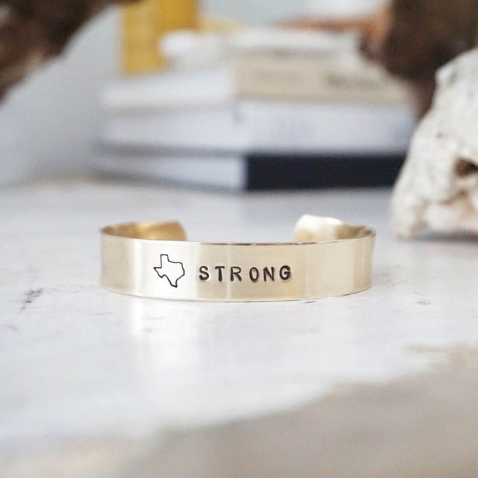 Hand-stamped Texas Strong bracelet, $40, by All The Wire at allthewire.com. The  Dallas area designers are donating $10 of every purchase to the Humane Society and  the American Red Cross.